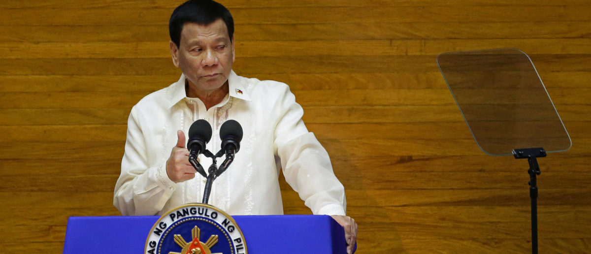 Philippine President Rodrigo Duterte delivers his State of the Nation address at the House of Representatives in Quezon city, Metro Manila, Philippines July 23, 2018. REUTERS/Czar Dancel