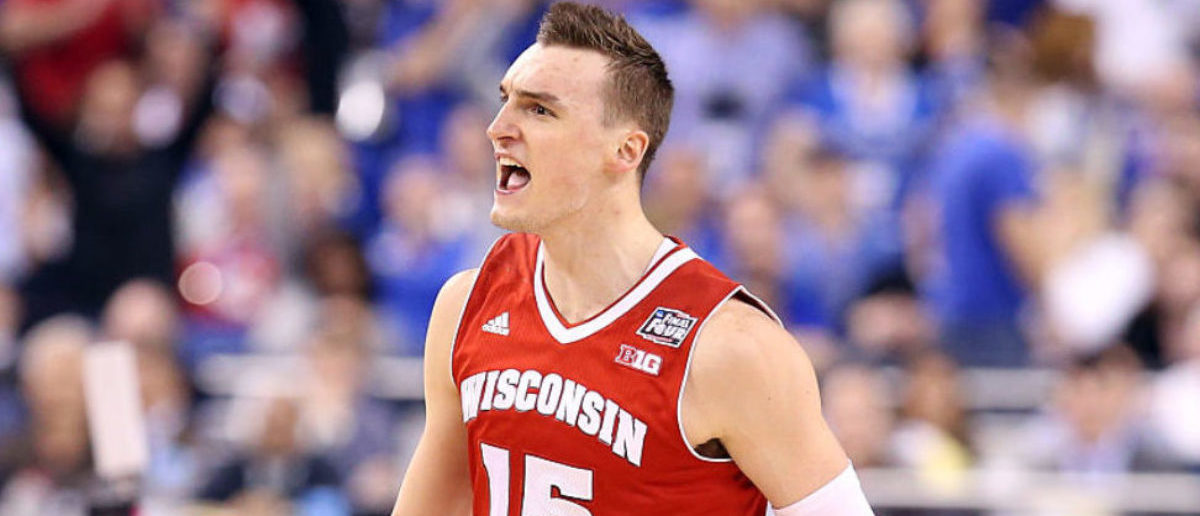 INDIANAPOLIS, IN - APRIL 04: Sam Dekker #15 of the Wisconsin Badgers reacts after a play late in the second half against the Kentucky Wildcats during the NCAA Men's Final Four Semifinal at Lucas Oil Stadium on April 4, 2015 in Indianapolis, Indiana. (Photo by Streeter Lecka/Getty Images)