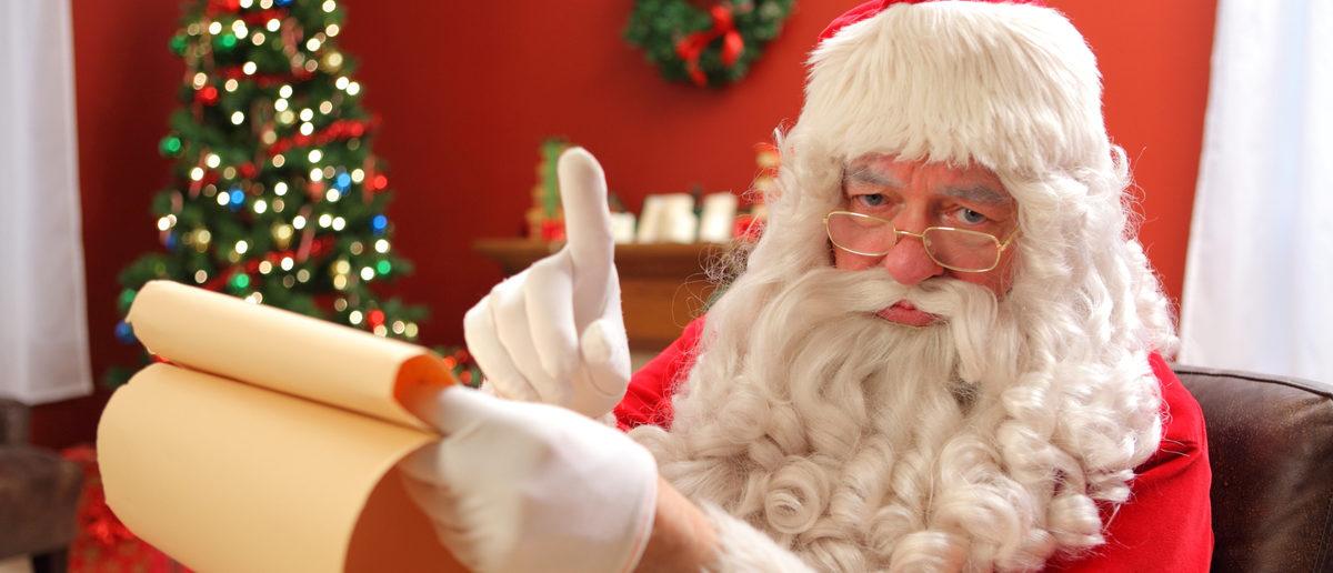 Santa Claus warns the naughty kids. (Shutterstock/Hurst Photo)