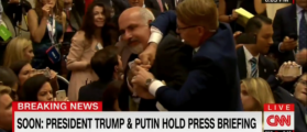 Protesting Reporter Forcibly Removed From Trump-Putin Press Conference