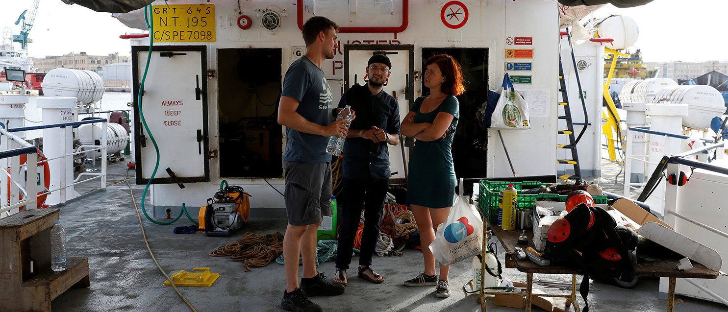 Crew members talk on the main deck of the German charity rescue ship, Sea-Watch 3, which has been detained by Maltese authorities, in Marsa, in Valletta's Grand Harbour, Malta July 2, 2018. REUTERS/Darrin Zammit Lupi
