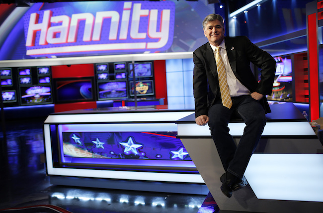 "Fox News Channel anchor Sean Hannity poses for photographs as he sits on the set of his show ""Hannity"" at the Fox News Channel's studios in New York City, October 28, 2014. REUTERS/Mike Segar"