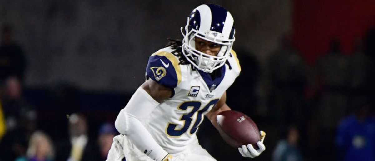 LOS ANGELES, CA - JANUARY 06: Running back Todd Gurley #30 of the Los Angeles Rams runs with the ball after taking a hand off during the first quarter of the NFC Wild Card Playoff game against the Atlanta Falcons at Los Angeles Coliseum on January 6, 2018 in Los Angeles, California. (Photo by Harry How/Getty Images)