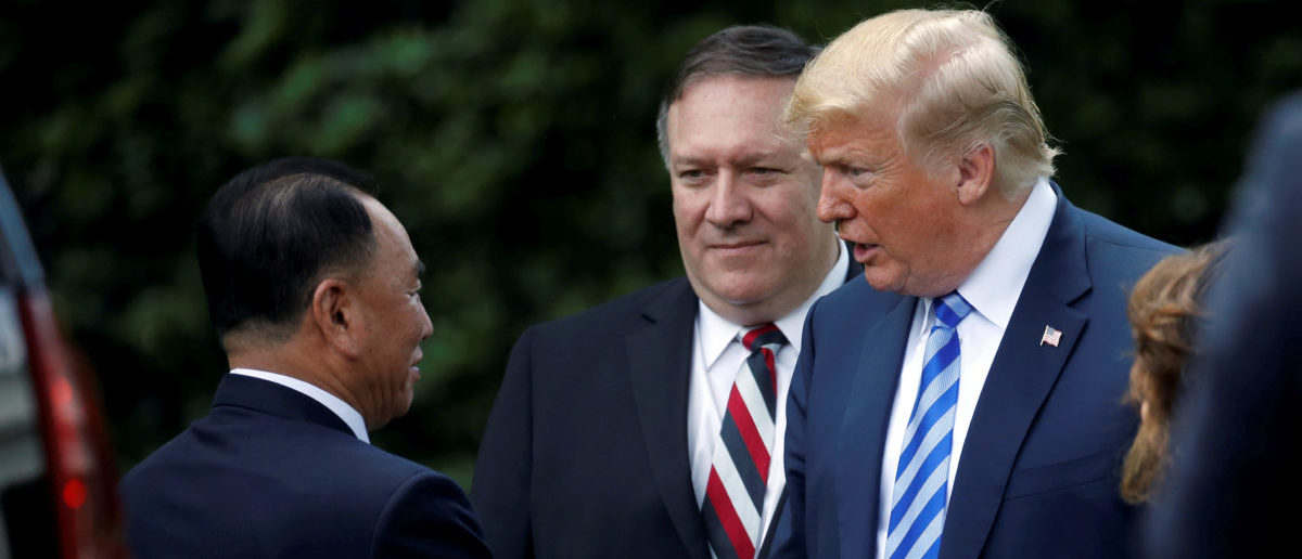 North Korean envoy Kim Yong Chol shakes hands with U.S. President Donald Trump as Secretary of State Mike Pompeo looks on after a meeting at the White House in Washington, U.S., June 1, 2018. REUTERS/Leah Millis