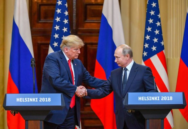"""US President Donald Trump (L) and Russia's President Vladimir Putin shake hands before attending a joint press conference after a meeting at the Presidential Palace in Helsinki, on July 16, 2018. - The US and Russian leaders opened an historic summit in Helsinki, with Donald Trump promising an """"extraordinary relationship"""" and Vladimir Putin saying it was high time to thrash out disputes around the world. (Photo credit should read YURI KADOBNOV/AFP/Getty Images)"""
