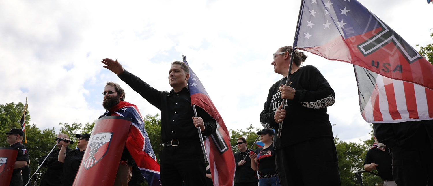 NEWNAN, GA - APRIL 21: Members and supporters of the National Socialist Movement, one of the largest neo-Nazi groups in the US, hold a rally on April 21, 2018 in Newnan, Georgia. Community members have opposed the rally and have come out to embrace racial unity in the small Georgia town. Fearing a repeat of the violence that broke out after Charlottesville, hundreds of police officers are stationed in the town during the rally in an attempt to keep the anti racist protesters and neo-Nazi groups separated. (Photo by Spencer Platt/Getty Images)