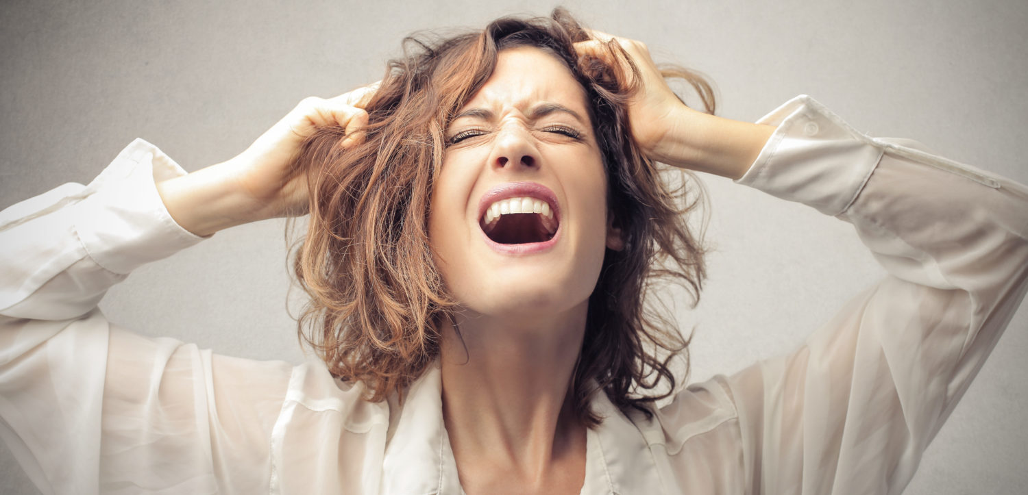 Woman screaming and crying (Shutterstock/Olly)