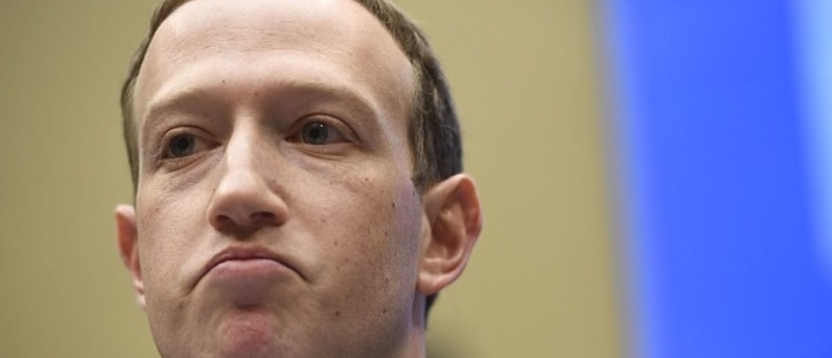 TOPSHOT - Facebook CEO and founder Mark Zuckerberg testifies during a US House Committee on Energy and Commerce hearing about Facebook on Capitol Hill in Washington, DC, April 11, 2018. (Photo: SAUL LOEB/AFP/Getty Images)