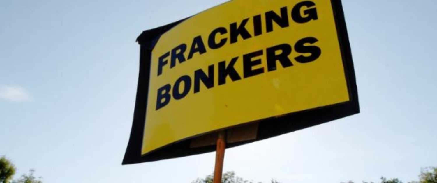 """An anti-fracking sign is displayed at the protest camp by the entrance to a site run by Cuadrilla Resources, outside the village of Balcombe in southern England August 6, 2013. Protesters have been blocking access to a drilling site in southern England as part of a campaign against the controversial """"fracking"""" process used in shale gas exploration, illustrating the potential battle ahead for Britain's nascent shale industry. REUTERS/Luke MacGregor"""