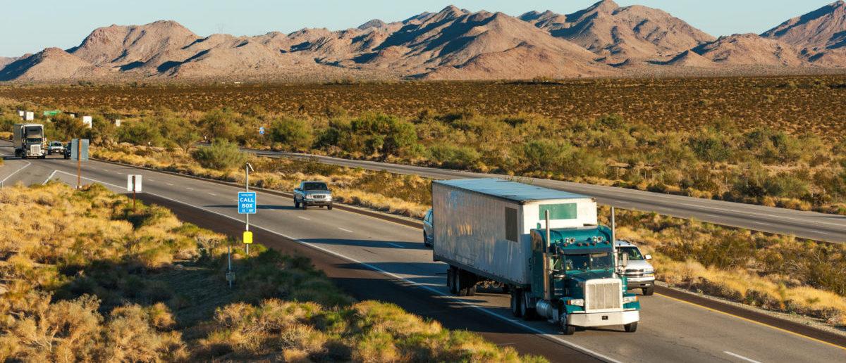 Traffic is moving across America on interstate I-10, Arizona. SHUTTERSTOCK/ Natalia Bratslavsky