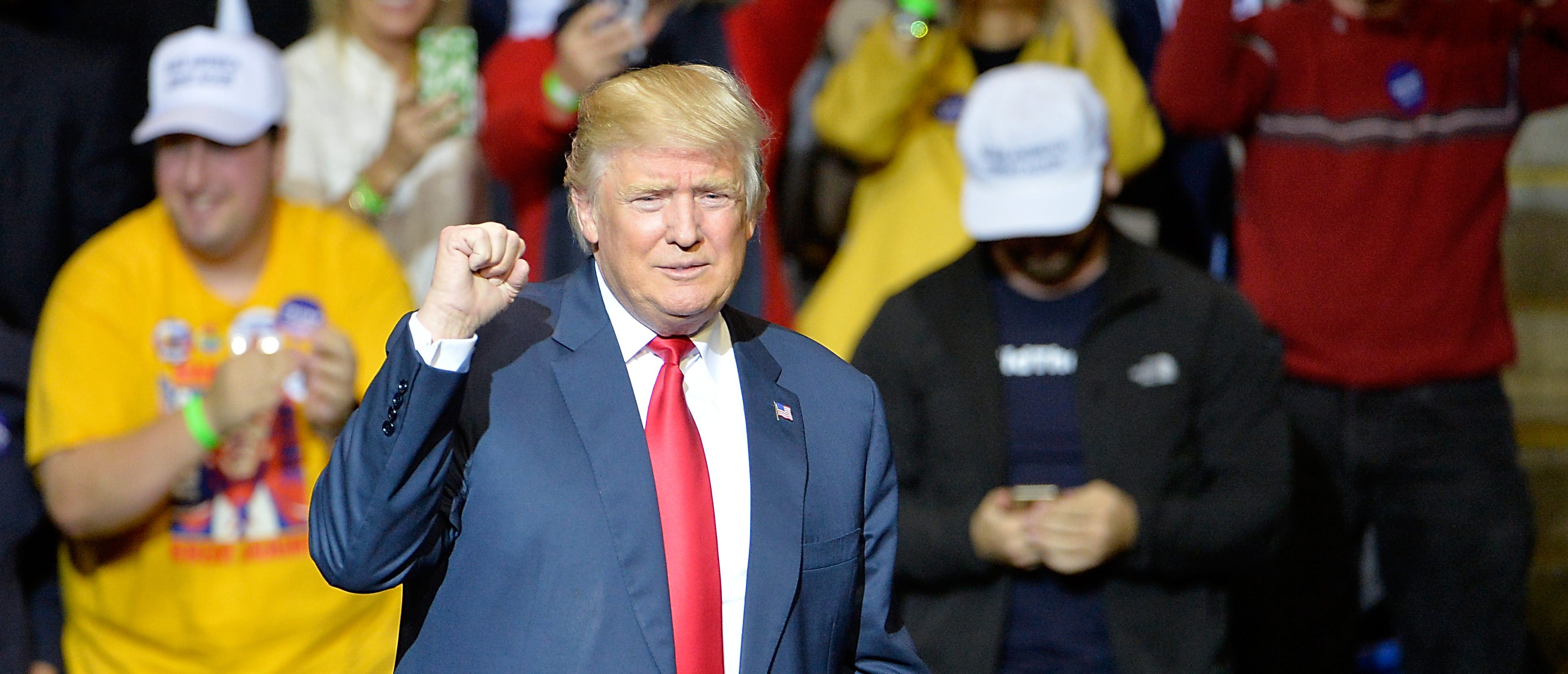 FAYETTEVILLE, NC - DECEMBER 06: President-elect Donald Trump pumps his fist to cheers at Crown Coliseum on December 6, 2016 in Fayetteville, North Carolina. Trump took time off from selecting the cabinet for his incoming administration to celebrate his victory in the general election. (Photo by Sara D. Davis/Getty Images)