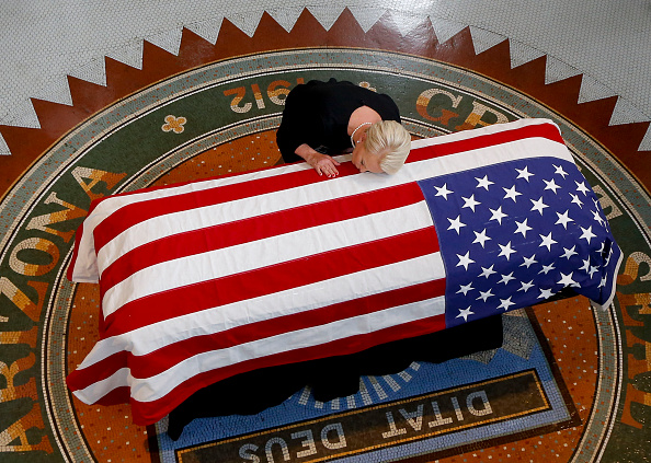 Cindy McCain, wife of US Senator John McCain, kisses his casket during a memorial service at the Arizona Capitol on August 29, 2018, in Phoenix. (ROSS D. FRANKLIN/AFP/Getty Images)