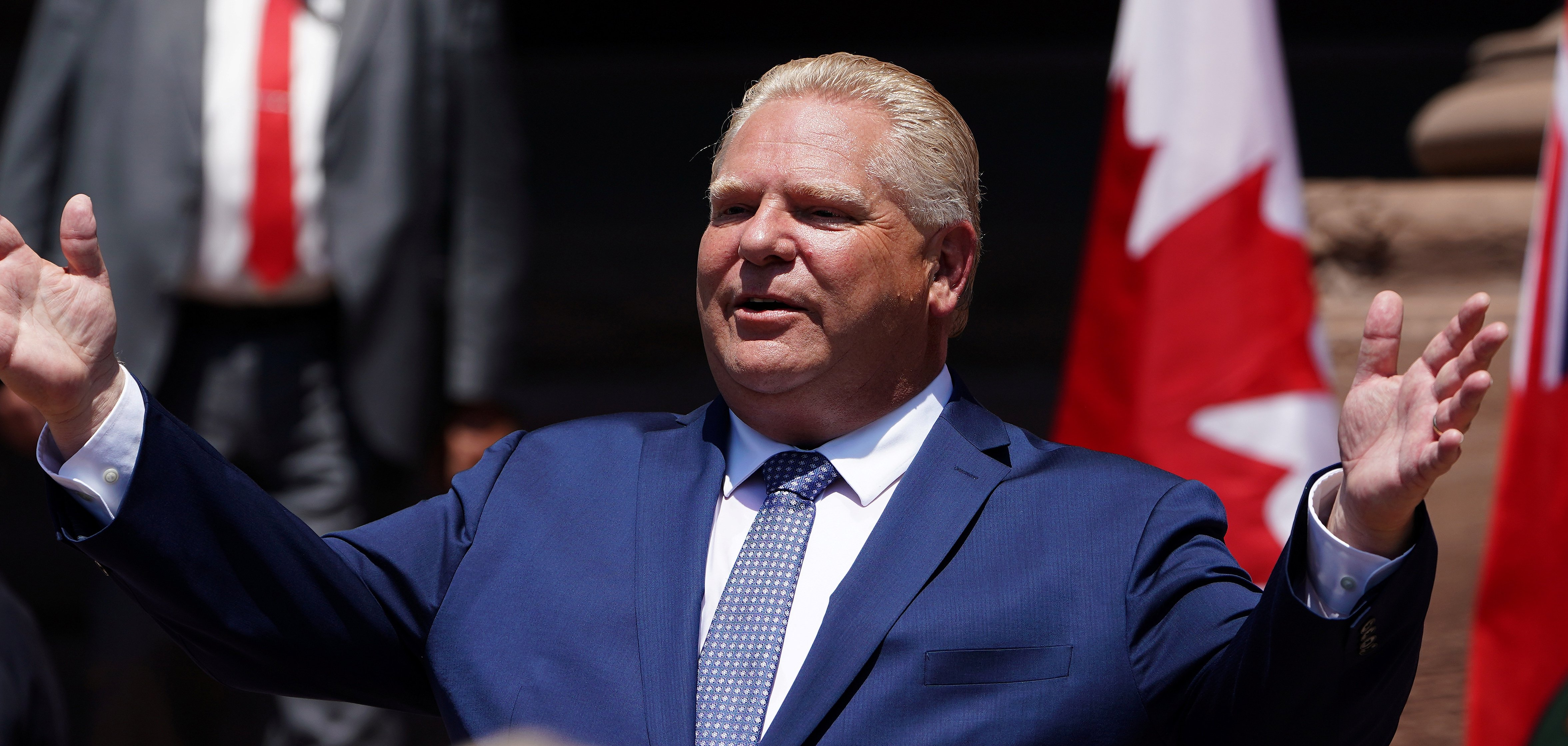 Ontario Premier Doug Ford gestures as he speaks during his unofficial swearing in ceremony in Toronto, Ontario, Canada, June 29, 2018. REUTERS/Carlo Allegri - RC183E9B2B20