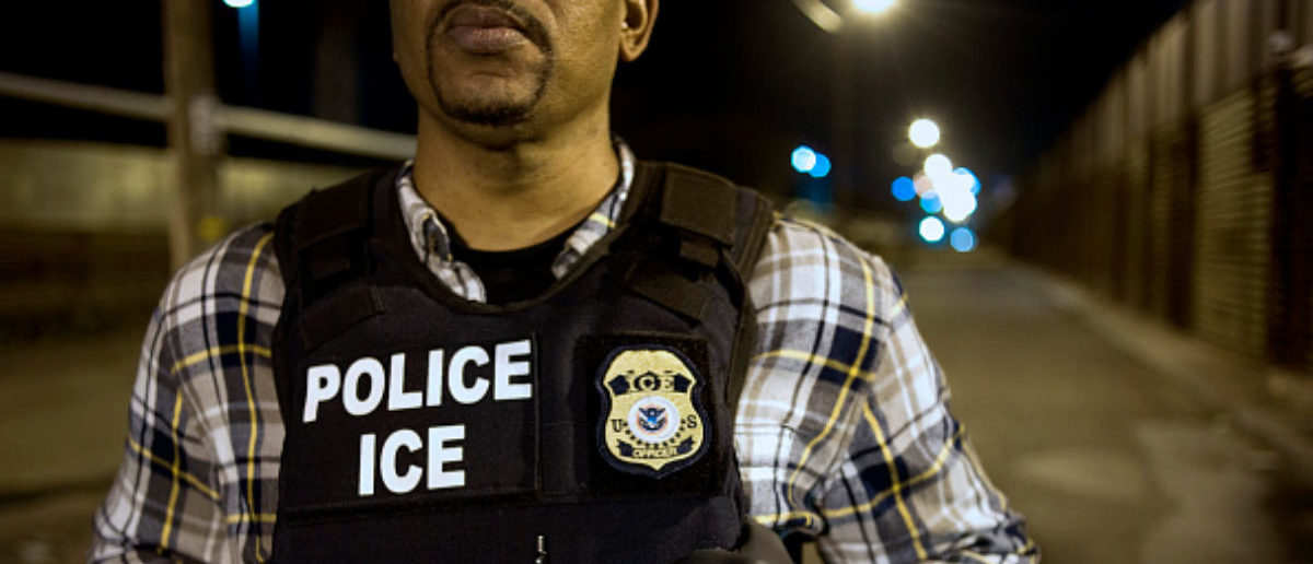 A U.S. Immigration and Customs Enforcement (ICE) agent waits as a group of undocumented men, not pictured, are deported to Mexico at the U.S.-Mexico border in San Diego, California, U.S., on Thursday, Feb. 26, 2015. The U.S. Department of Homeland Security is nearing a partial shutdown as the agency's funding is set to expire Friday -- something Senate Majority Leader Mitch McConnell had said wouldn't happen on his watch. Photographer: David Maung/Bloomberg via Getty Images