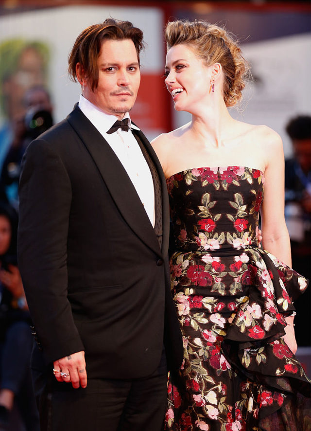 VENICE, ITALY - SEPTEMBER 05: Johnny Depp and actress Amber Heard attend a premiere for 'The Danish Girl' during the 72nd Venice Film Festival at on September 5, 2015 in Venice, Italy. (Photo by Tristan Fewings/Getty Images)
