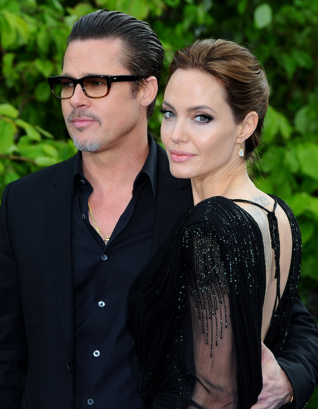 """Brad Pitt and Angelina Jolie attend a private reception as costumes and props from Disney's """"Maleficent"""" are exhibited in support of Great Ormond Street Hospital at Kensington Palace on May 8, 2014 in London, England. (Photo by Anthony Harvey/Getty Images)"""