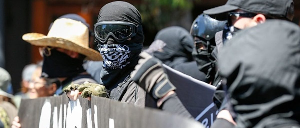 Antifa militants march with counter protesters, as they protest an alt-right rally on August 5, 2018 in downtown Berkeley, California. (Photo by Amy Osborne / AFP) (Photo credit should read AMY OSBORNE/AFP/Getty Images)