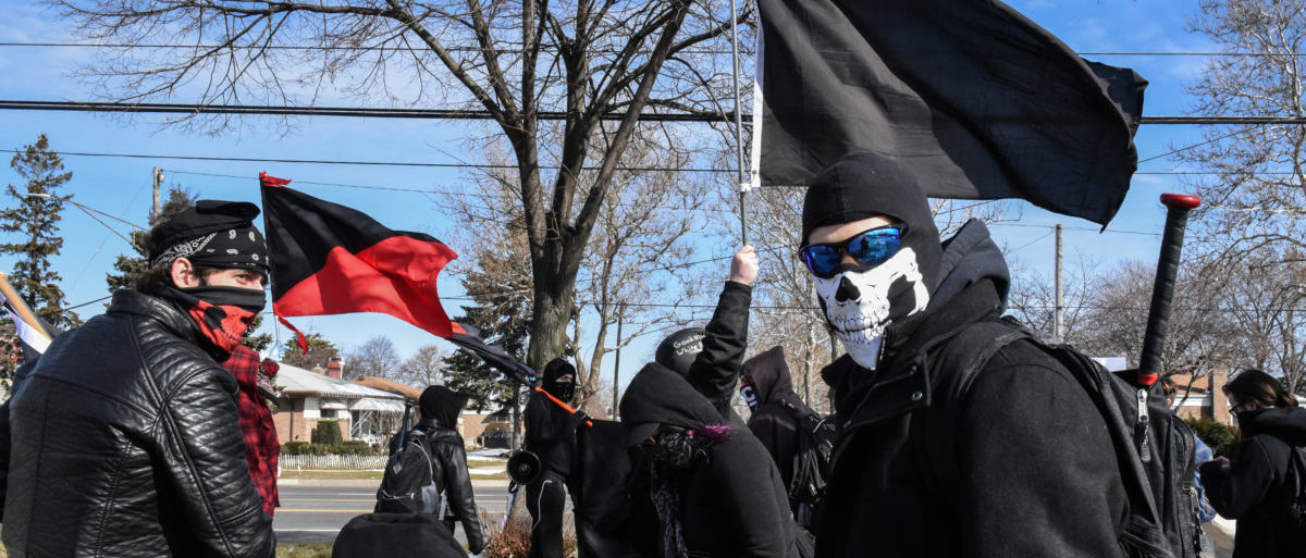 Members of the Great Lakes anti-fascist organization (Antifa) protest against the Alt-right outside a hotel in Warren, Michigan, U.S., March 4, 2018. REUTERS/Stephanie Keith