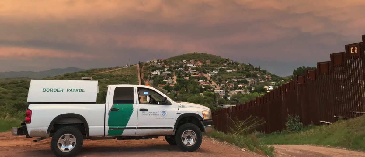 NOGALES, AZ - JULY 22: A U.S. Border Patrol agent watches over the U.S.-Mexico border at dusk on July 22, 2018 in Nogales, Arizona. President Trump has proposed replacing the fence with a wall. (Photo by John Moore/Getty Images)