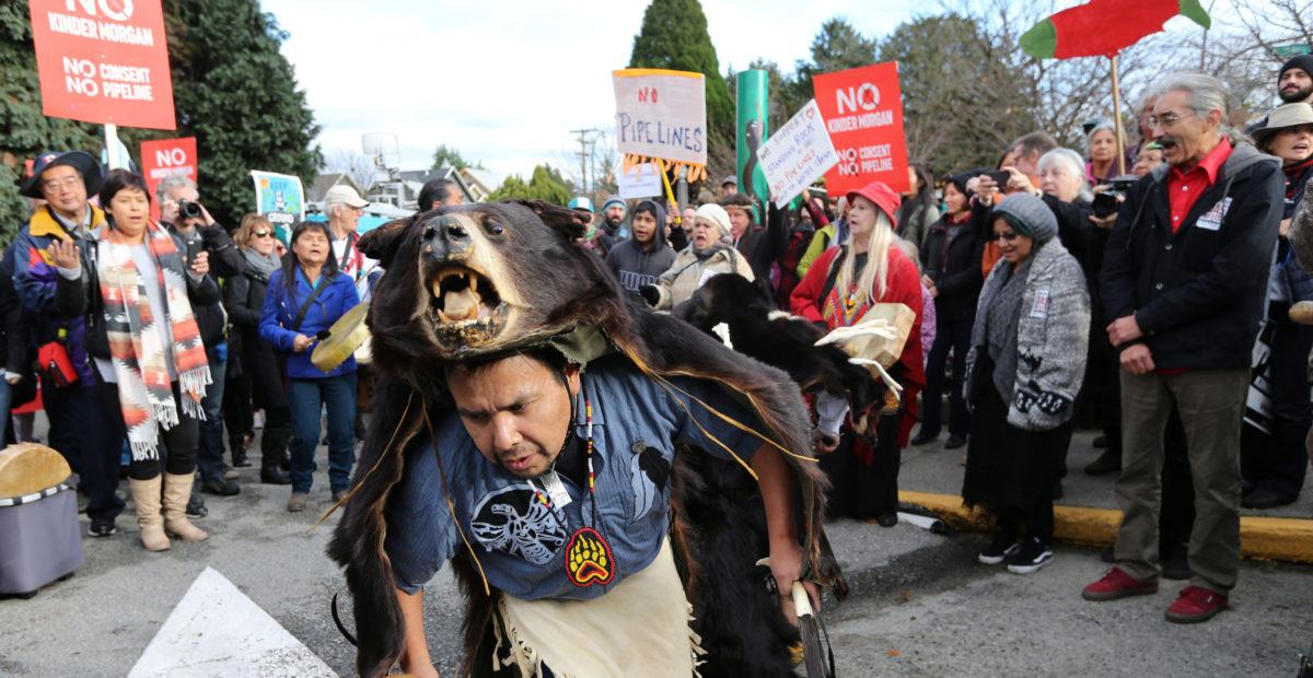 Thomas Terry, a St'at'imc Bear Dancer from Xwisten First Nation, dances before a march protesting against the proposed expansion of Kinder Morgan's Trans Mountain Pipeline in Vancouver, British Columbia, Canada November 19, 2016. REUTERS/Chris Helgren