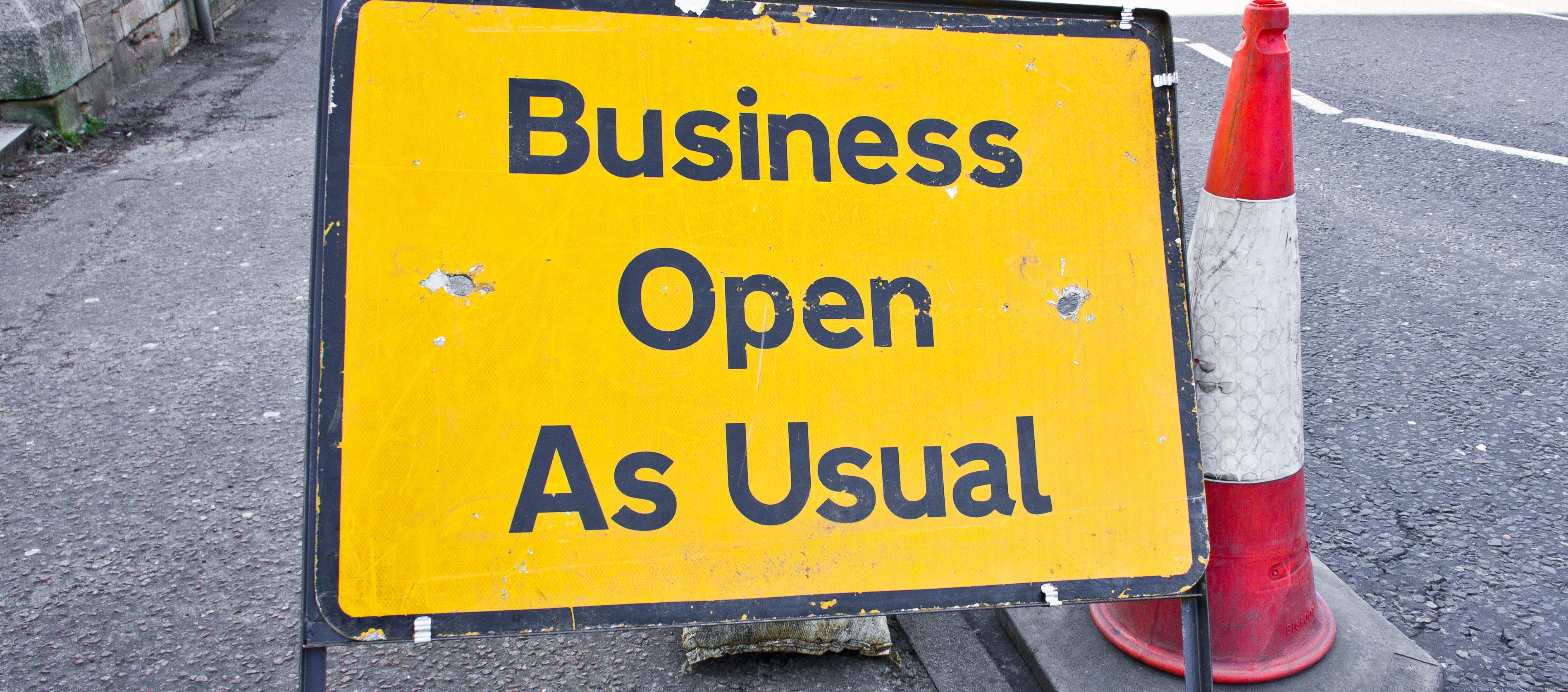 Business as usual sign (Shutterstock/Tom Gowanlock)