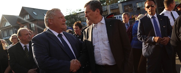 TORONTO, ON-. Mayor John Tory and Ontario Premier Doug Ford together at he start of the march. Thousands gather for support and comfort in this time of grief and sadness to the community. July 25, 2018. (Rene Johnston/Toronto Star via Getty Images)