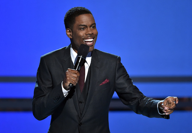 Host Chris Rock speaks onstage during the BET AWARDS '14 at Nokia Theatre L.A. LIVE on June 29, 2014 in Los Angeles, California. (Photo by Kevin Winter/Getty Images for BET)