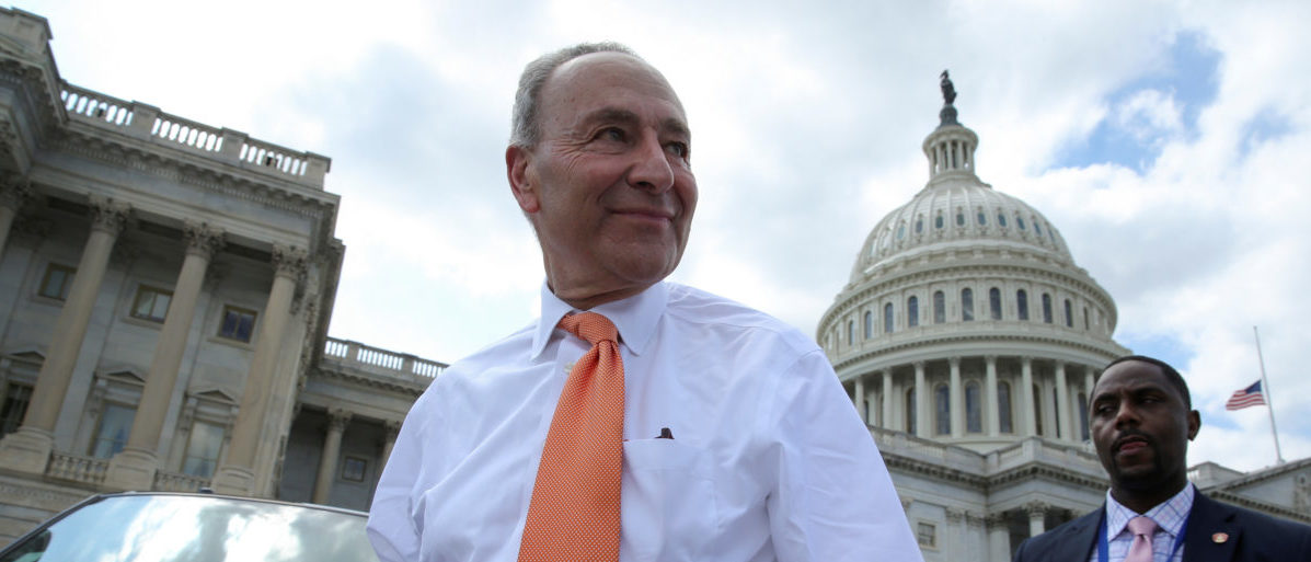 "U.S. Senate Minority Leader Chuck Schumer (D-NY) departs after Democrats' ""Better Deal"" platform rally at the U.S. Capitol in Washington, U.S. May 21, 2018. REUTERS/Jonathan Ernst"