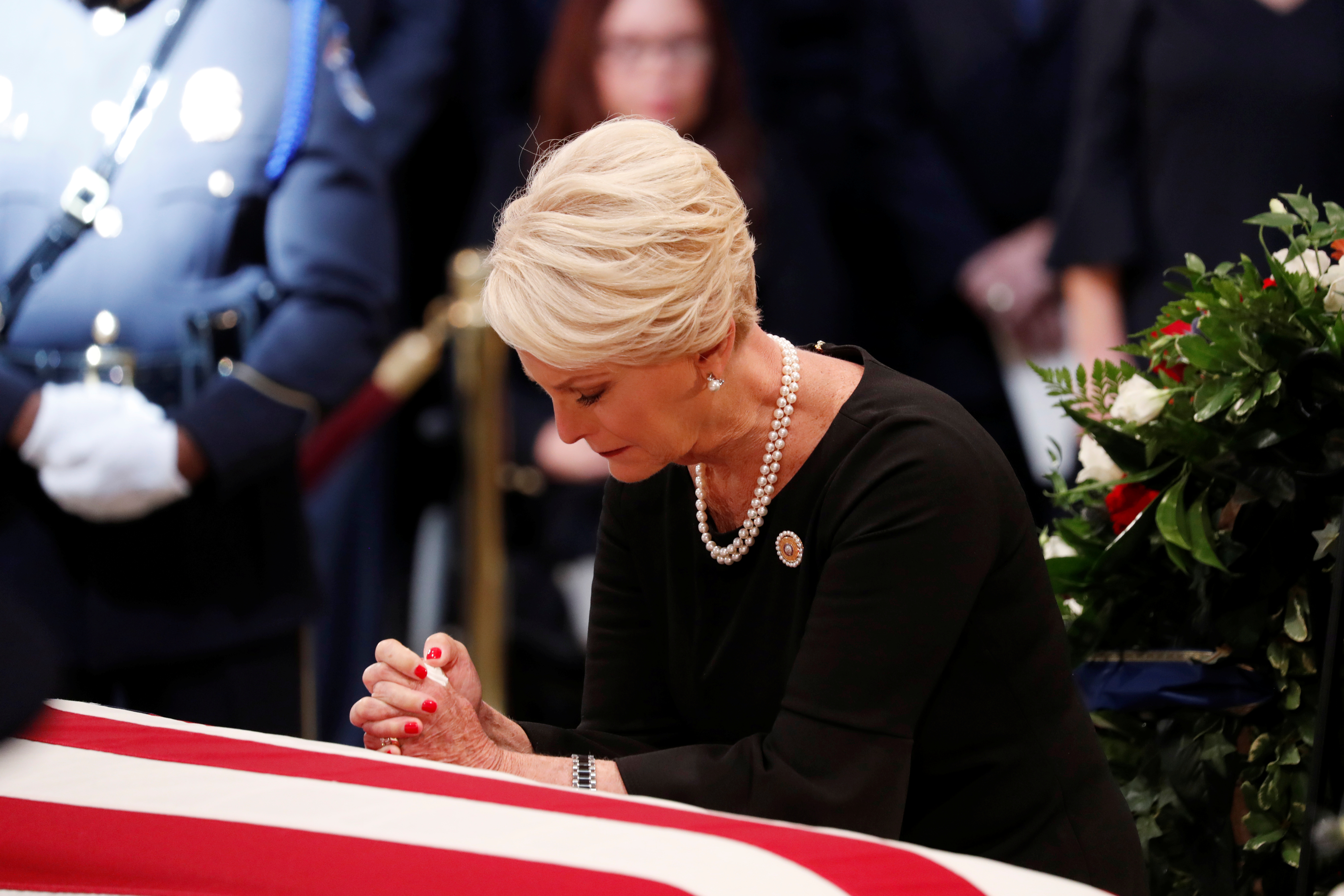 Cindy McCain, wife of late U.S. Senator John McCain, mourns at her husband's casket during ceremonies honoring Senator McCain inside the U.S. Capitol Rotunda in Washington, August 31, 2018. REUTERS/Kevin Lamarque
