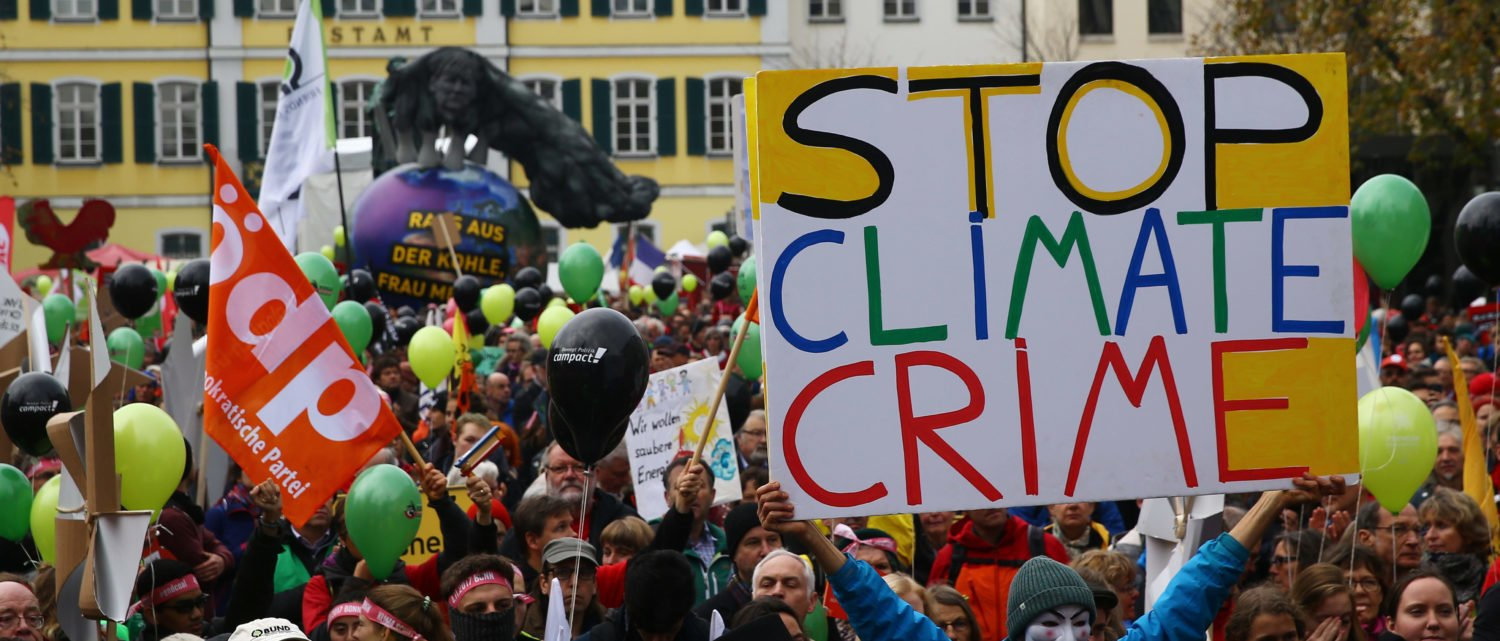 "People march during a demonstration under the banner ""Protect the climate - stop coal"" two days before the start of the COP 23 UN Climate Change Conference hosted by Fiji but held in Bonn, Germany November 4, 2017. REUTERS/Wolfgang Rattay"