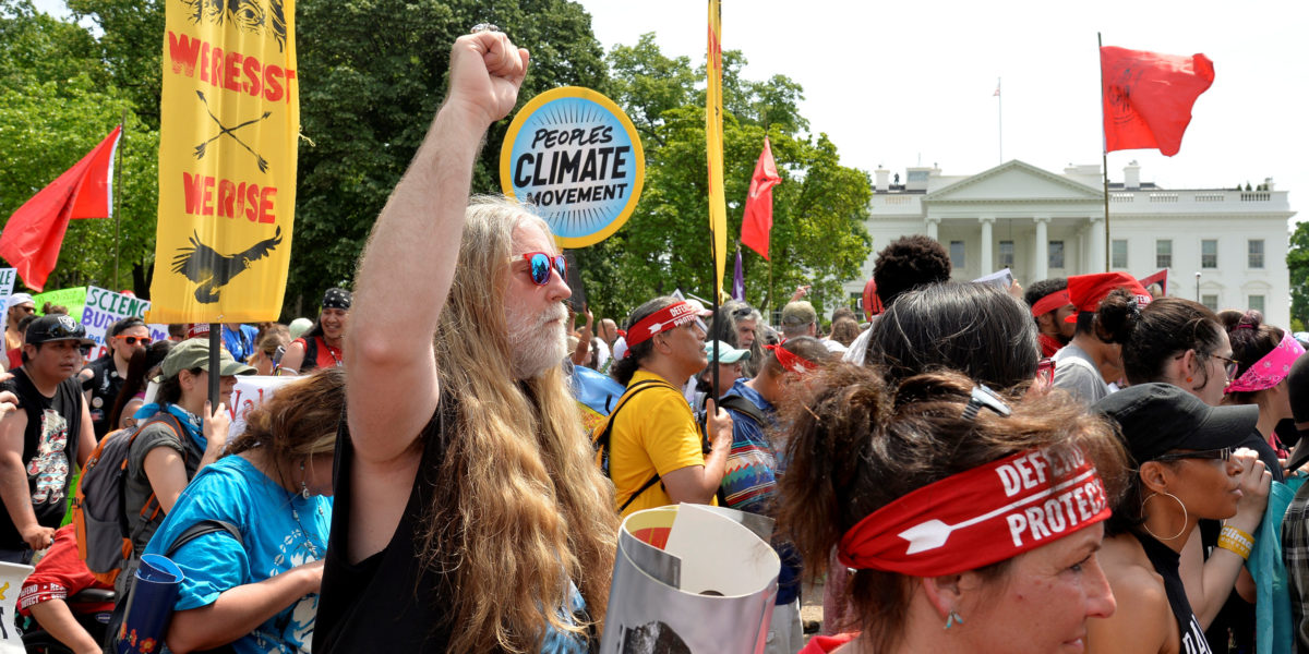 Demonstrators march down Pennsylvania Avenue past the White House during a People's Climate March, to protest U.S. President Donald Trump's stance on the environment, in Washington, U.S., April 29, 2017. REUTERS/Mike Theiler - RC167FD0CF10