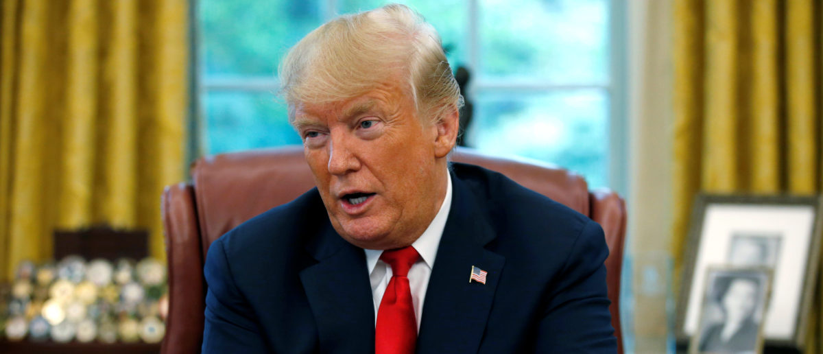 U.S. President Donald Trump answers a question during an interview with Reuters in the Oval Office of the White House in Washington, U.S. August 20, 2018. REUTERS/Leah Millis