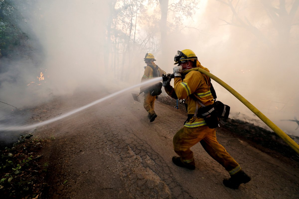 A firefighter knocks down hotspots to slow the spread of the River Fire (Mendocino Complex) in Lakeport, California, July 31, 2018. REUTERS/Fred Greaves/File Photo