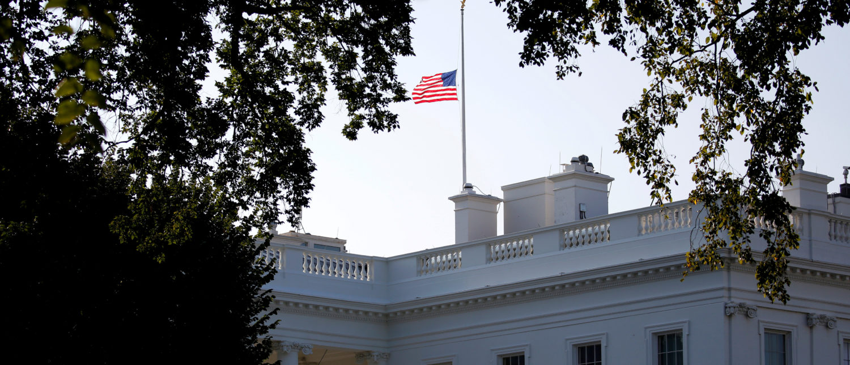 A flag flies at half-staff in honor of Senator John McCain (R-AZ) at the White House in Washington, U.S., August 26, 2018. REUTERS/Joshua Roberts