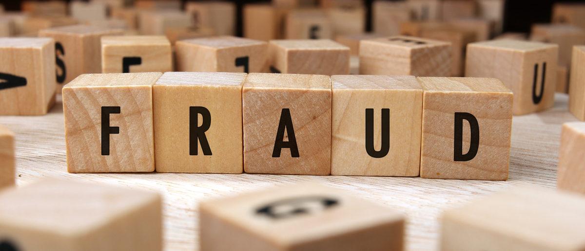 """""""Fraud"""" written on wooden blocks. (Shutterstock/TypoArt BS)"""