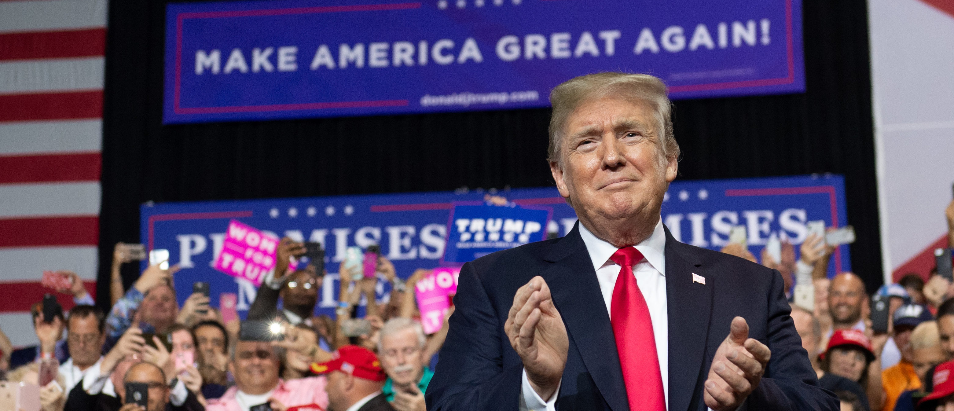 US President Donald Trump applauds during a campaign rally at the Florida State Fairgrounds Expo Hall in Tampa, Florida, on July 31, 2018. (Photo by SAUL LOEB/AFP/Getty Images)