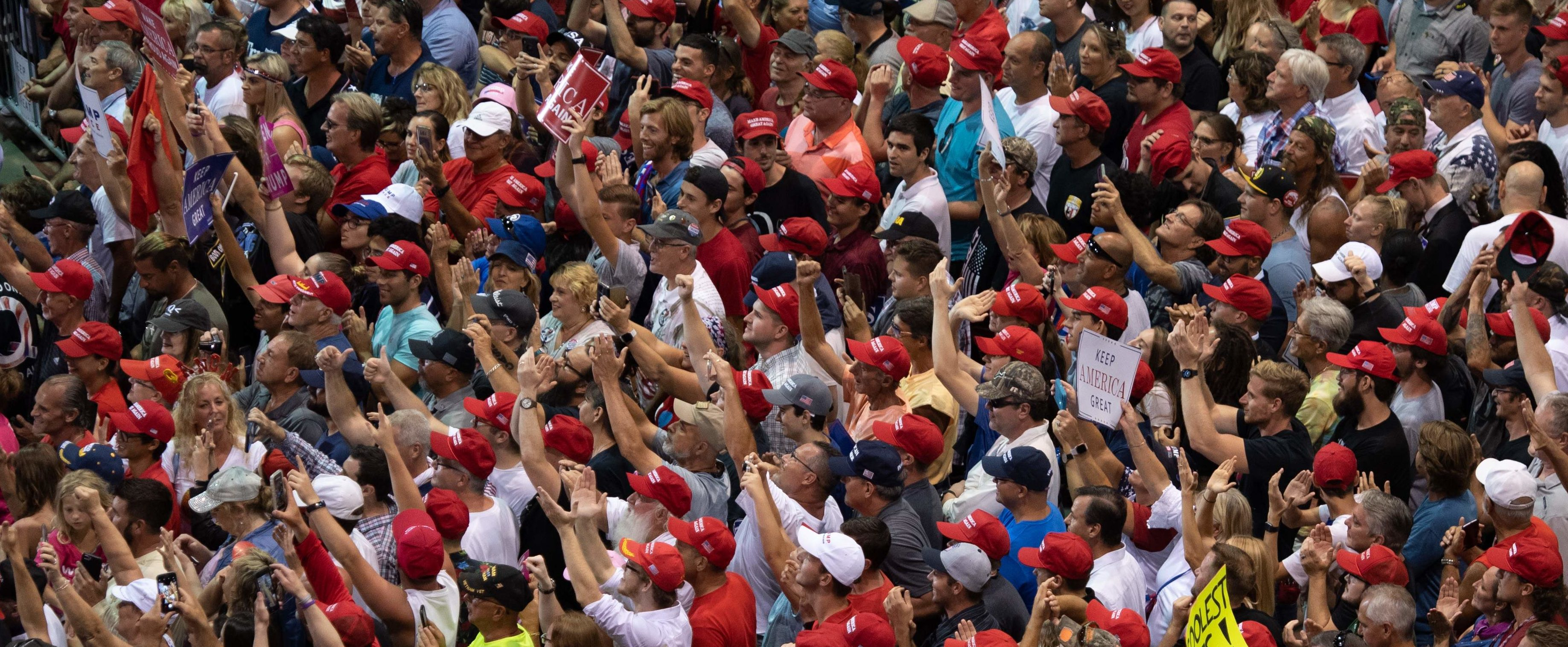 Supporters cheer as US President Donald Trump speaks during a campaign rally at Florida State Fairgrounds Expo Hall in Tampa, Florida, on July 31, 2018. (Photo by SAUL LOEB / AFP)