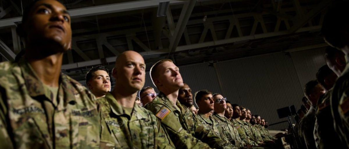 Troops listen while US President Donald Trump speaks during a signing ceremony for the John S. McCain National Defense Authorization Act for Fiscal Year 2019 at Fort Drum, New York, on August 13, 2018. (Photo by Brendan Smialowski / AFP) (Photo credit should read BRENDAN SMIALOWSKI/AFP/Getty Images)