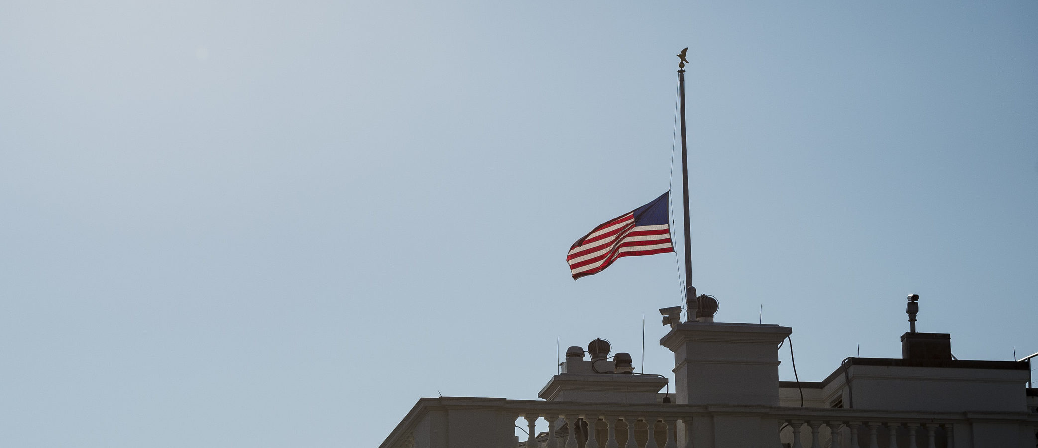 WASHINGTON, DC - AUGUST 26: The American flag flies at half staff over the White House honoring Senator John McCain on August 26, 2018 in Washington, D.C. Senator McCain was diagnosed with brain cancer in 2017 and passed away on August 25, 2018. (Photo by Pete Marovich-Pool/Getty Images)