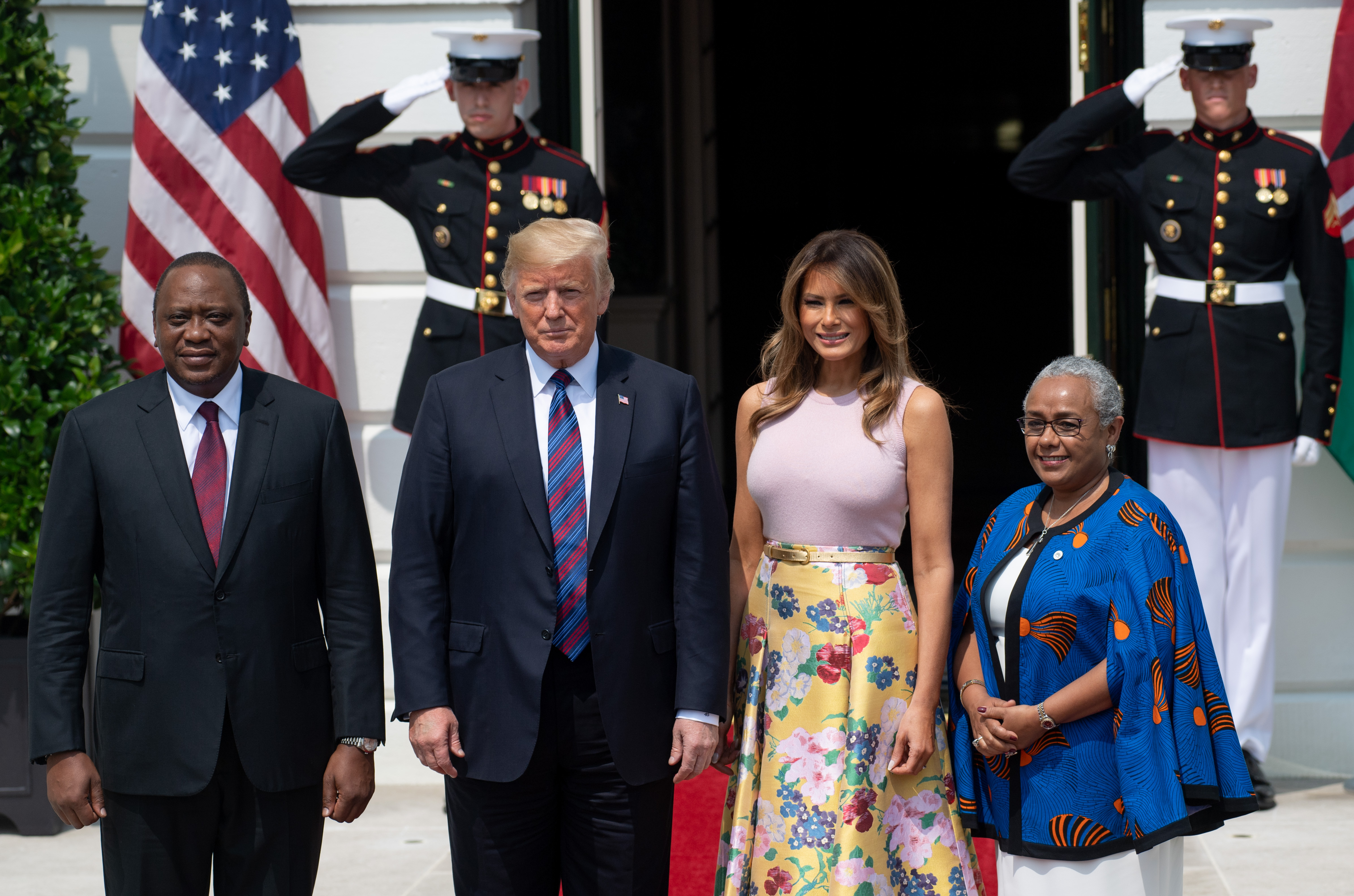 President Donald Trump and First Lady Melania Trump welcome Kenyan President Uhuru Kenyatta (L) and his wife, Margaret Kenyatta (R), as they arrive at the South Lawn of the White House in Washington, DC, August 27, 2018. (Photo: SAUL LOEB/AFP/Getty Images)