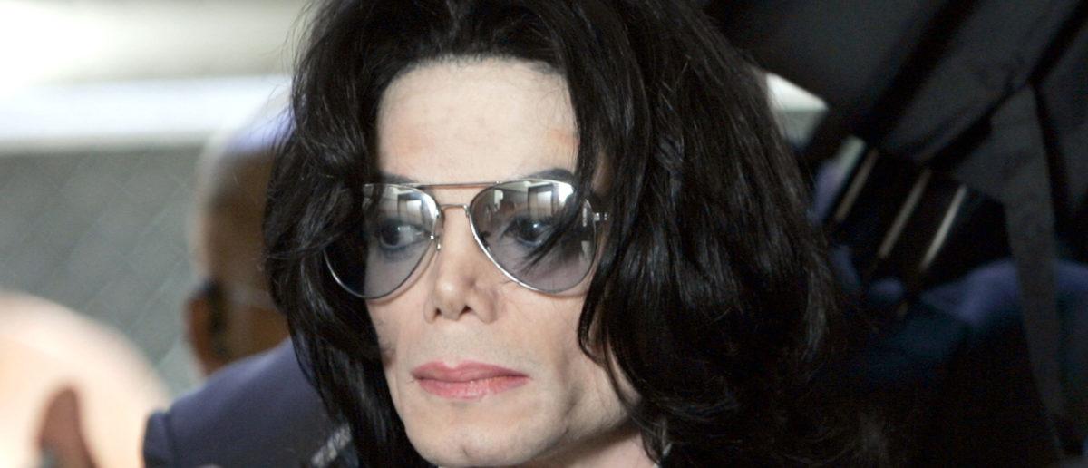 Michael Jackson prepares to enter the Santa Barbara County Superior Court to hear the verdict read in his child molestation case June 13, 2005 in Santa Maria, California. Kevork Djansezian-Pool/Getty Images