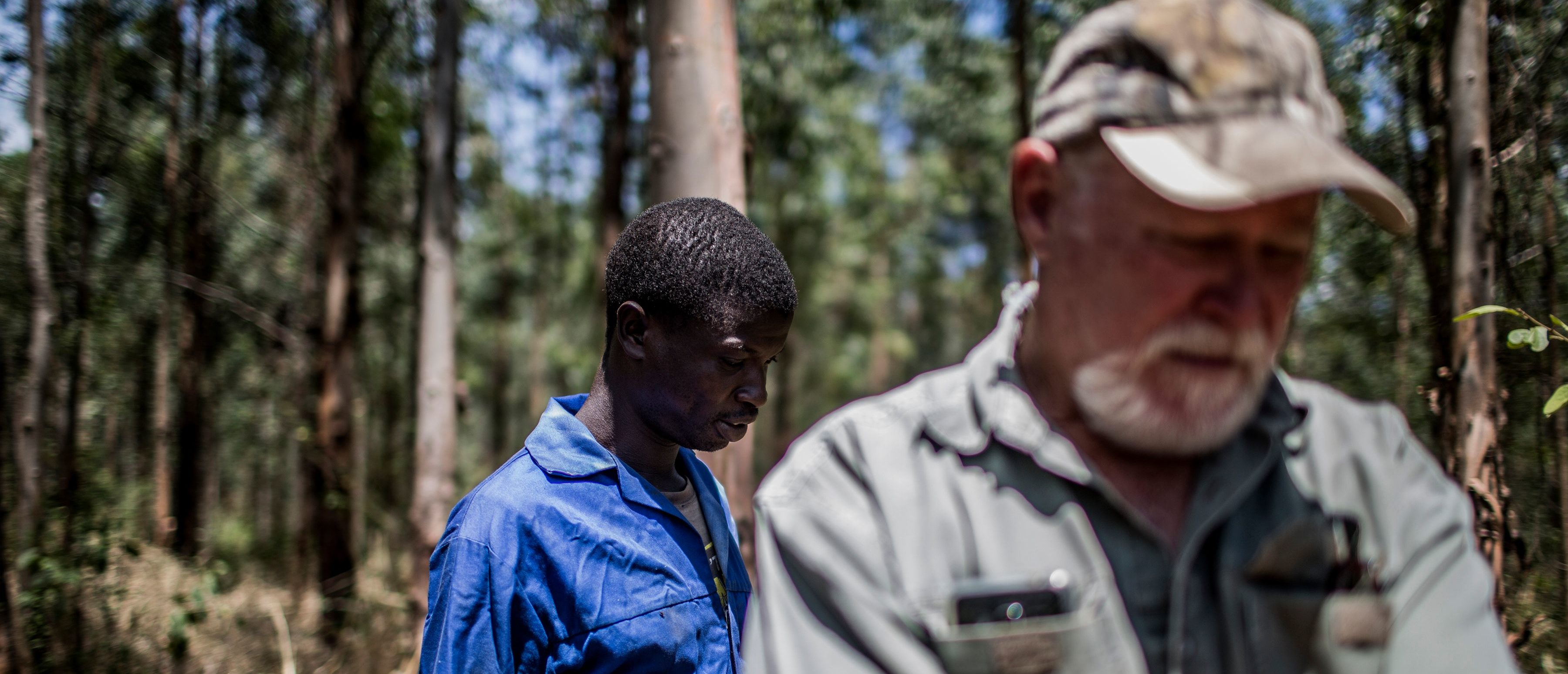 Farm worker Mogoala Justice Ratalele (L) stand near his boss farmer Hans Bergmann (R) after an incident in which he was held at gunpoint for the theft of the chainsaw that he was working with, on November 2, 2017, in Tzaneen, South Africa. A long campaign of violence against the country's farmers, who are largely white, has inflamed political and racial tensions nearly a quarter-of-a-century after the fall of apartheid. / AFP PHOTO / GULSHAN KHAN (Photo credit should read GULSHAN KHAN/AFP/Getty Images)