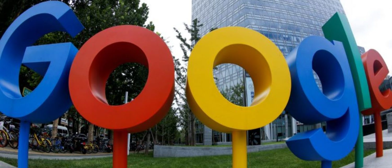 The brand logo of Alphabet Inc's Google is seen outside its office in Beijing, China August 8, 2018. Picture taken with a fisheye lens. REUTERS/Thomas Peter