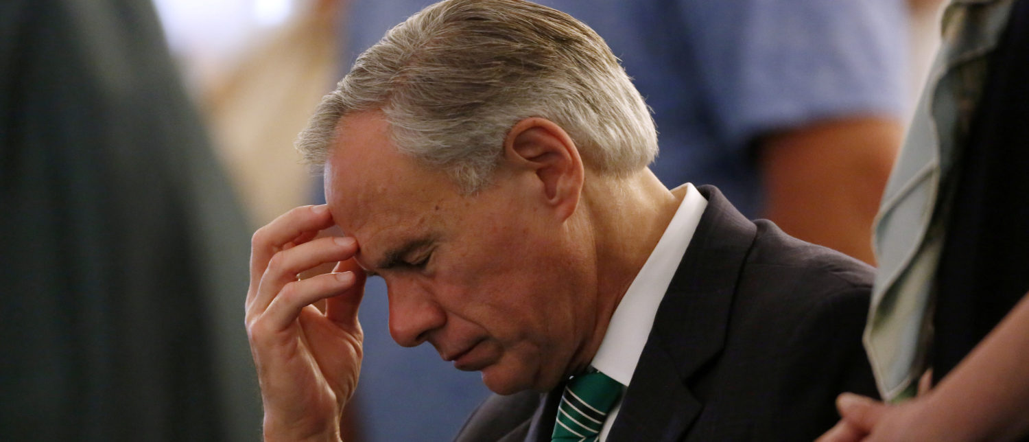 Texas Governor Greg Abbott reacts during prayer services at the Arcadia First Baptist Church in Santa Fe, Texas, U.S., May 20, 2018. REUTERS/Jonathan Bachman -