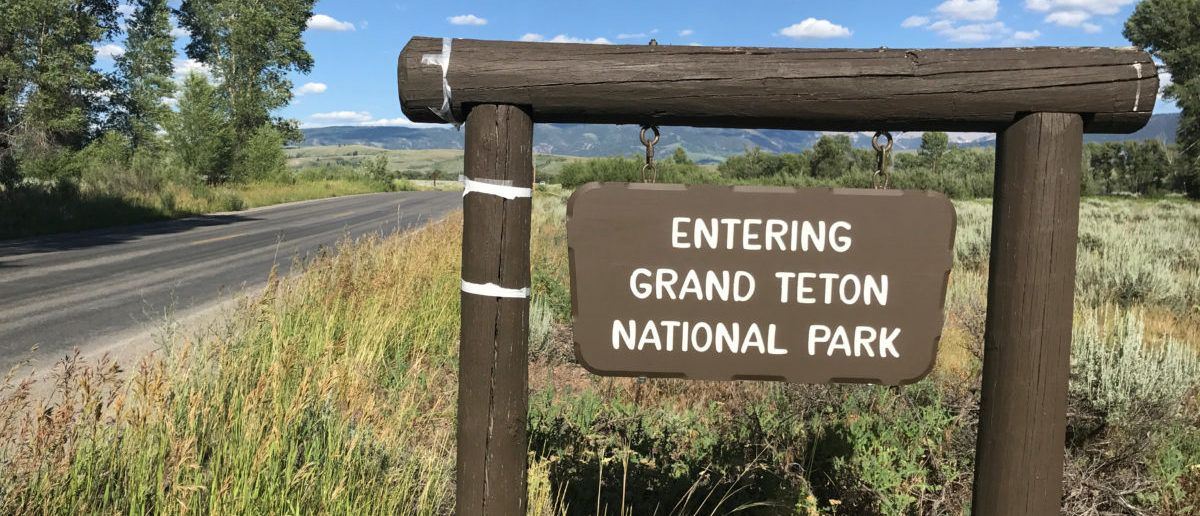 A signpost greets travellers at the Gros Ventre entrance to Grand Teton National Park, in Jackson Hole, Wyoming, U.S, July 12, 2017. Picture taken July 12, 2017. REUTERS/Ann Saphir
