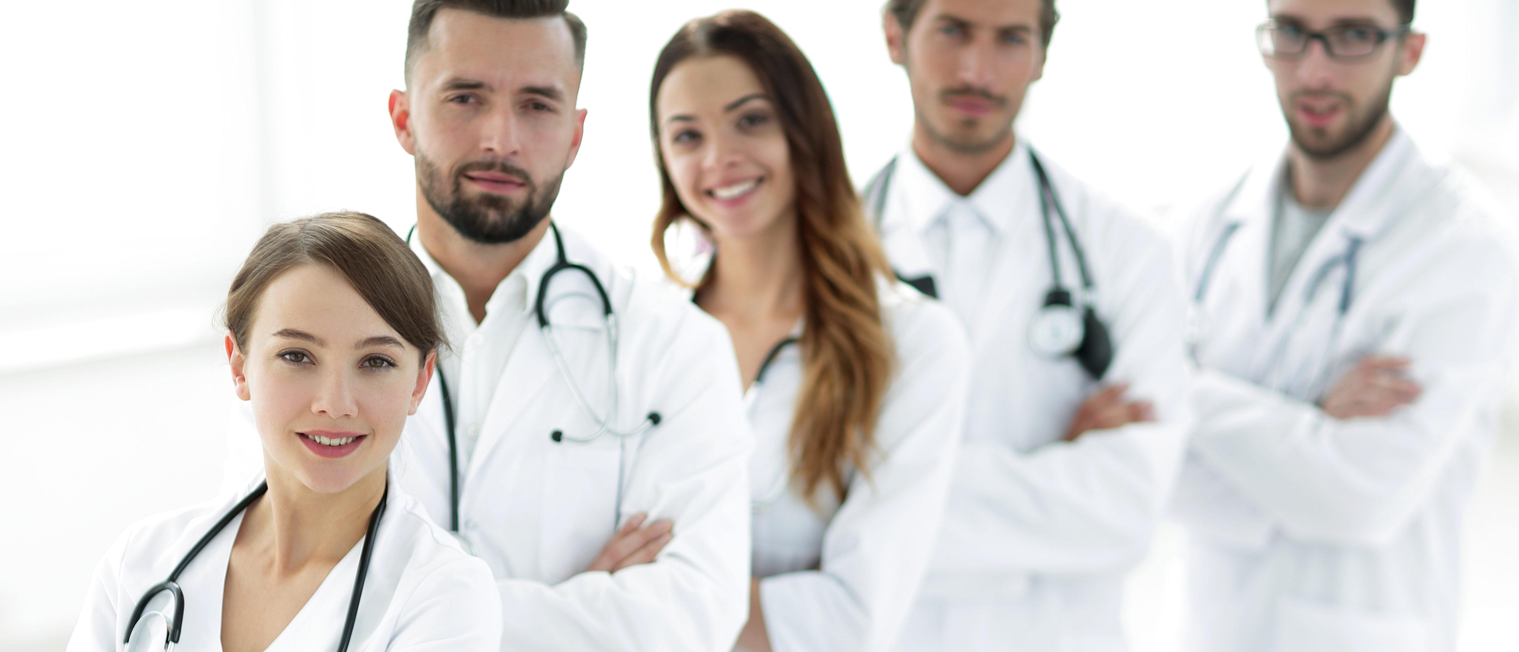 Group of doctors in white coats (Shutterstock/ASDF MEDIA)