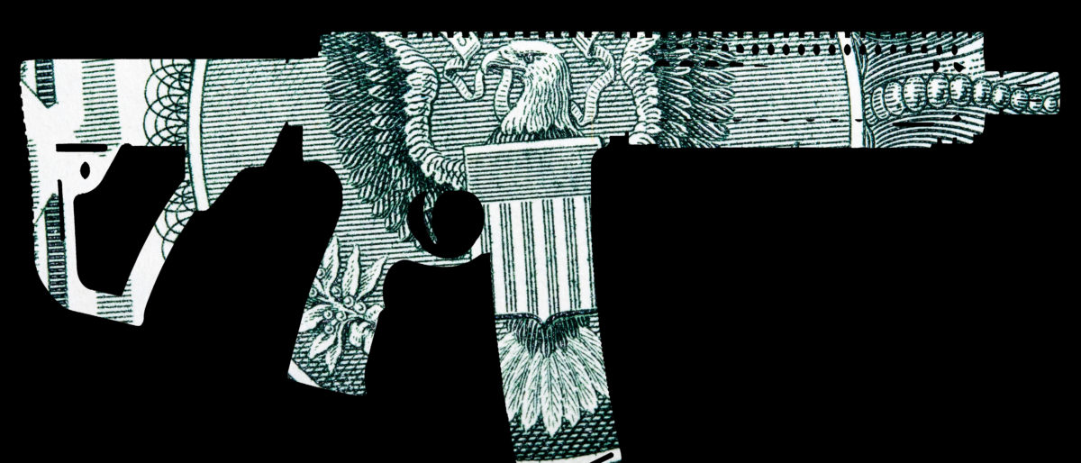 Guns and Money. Representing Shootings in America. Shape of Automatic Gun over detail of United States of America Dollar Bill [Shutterstock/Doug Shutter]