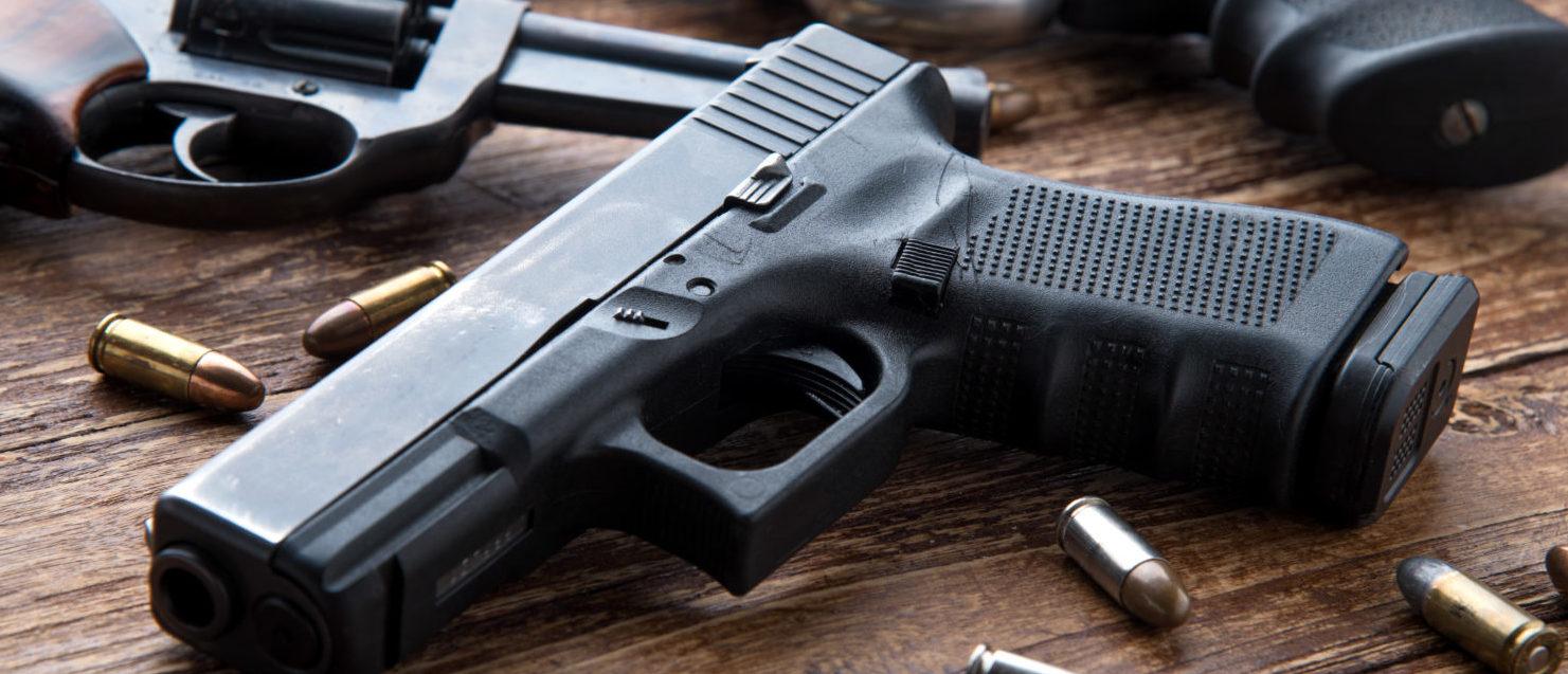 Guns With Ammunition (Shutterstock/ Kiattipong)