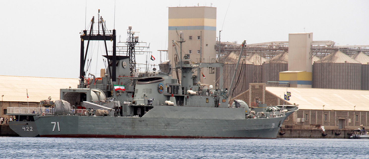 """Iranian military ships frigate """"Alvand"""" (R) and light replenishment ship """"Bushehr"""" are seen docked for refueling on May 6, 2014 in Port Sudan, 250 kilometres (155 miles) across the Red Sea from Iran's regional rival Saudi Arabia. Sudan's army spokesman Sawarmi Khaled Saad said the warships, one of them a navy supply ship, had arrived in Port Sudan, where civilians could tour the vessels during their port call. Naval vessels from Iran have periodically stopped in Port Sudan for what Khartoum describes as normal port calls. AFP PHOTO/STR (Photo credit should read STR/AFP/Getty Images)"""