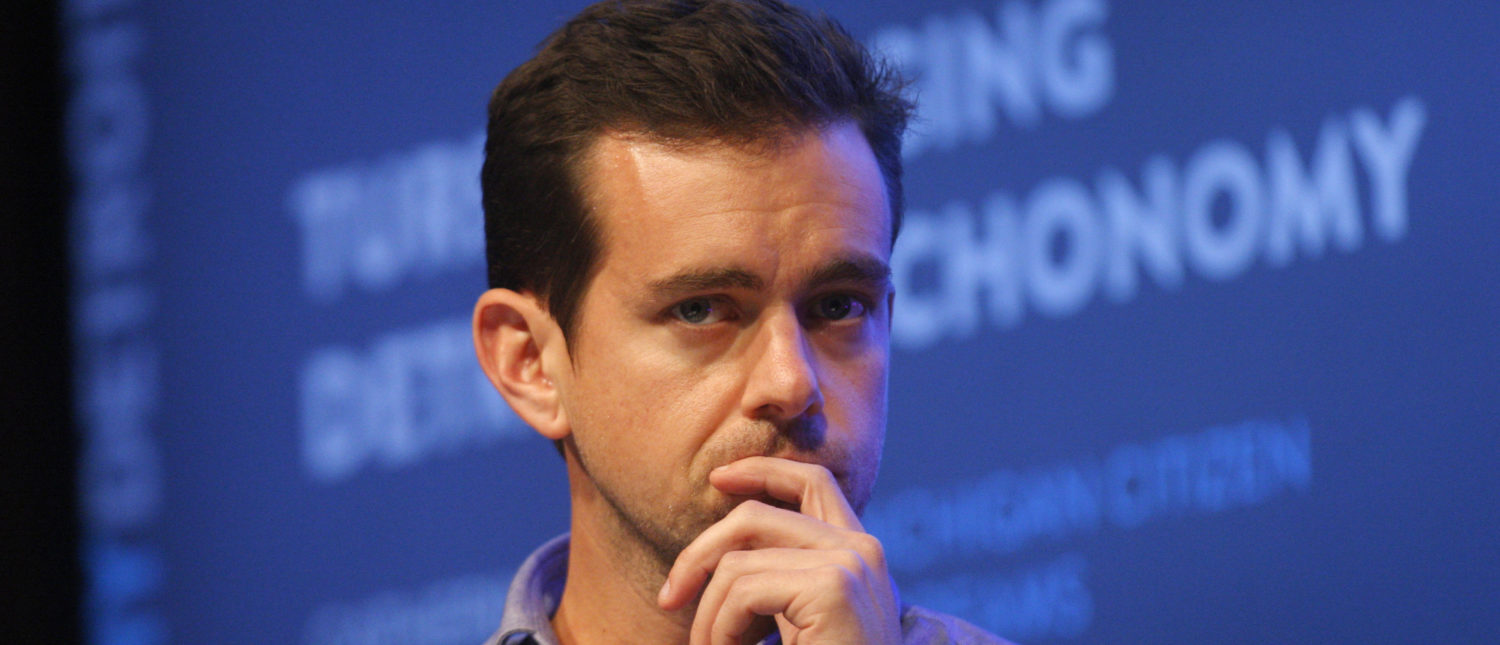 Jack Dorsey, chairman of Twitter and CEO of Square, listens to a fellow panelist during a Techonomy Detroit panel discussion held at Wayne State University in Detroit, Michigan September 17, 2013. REUTERS/Rebecca Cook